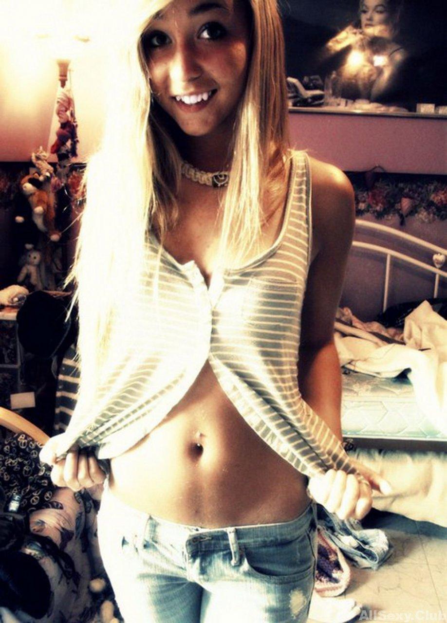Lovely and skinny blonde teen girl taking nude selfies